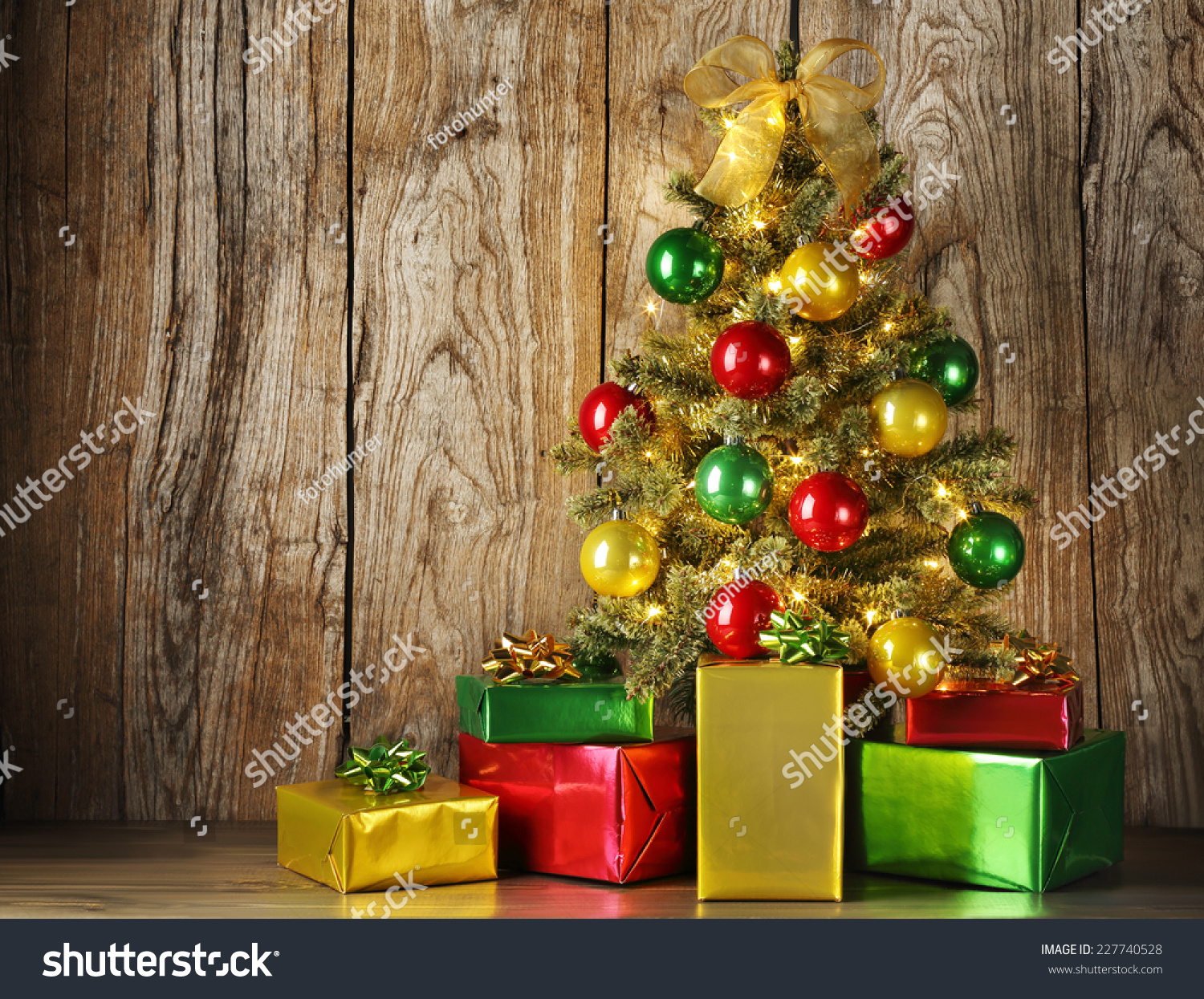 Christmas tree with gift boxes on grunge wood background