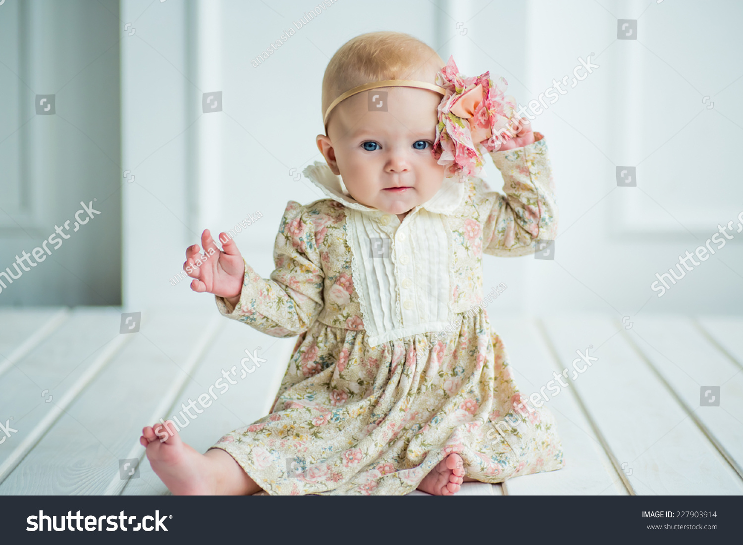 small cute baby girl adorable flower stock photo (royalty free
