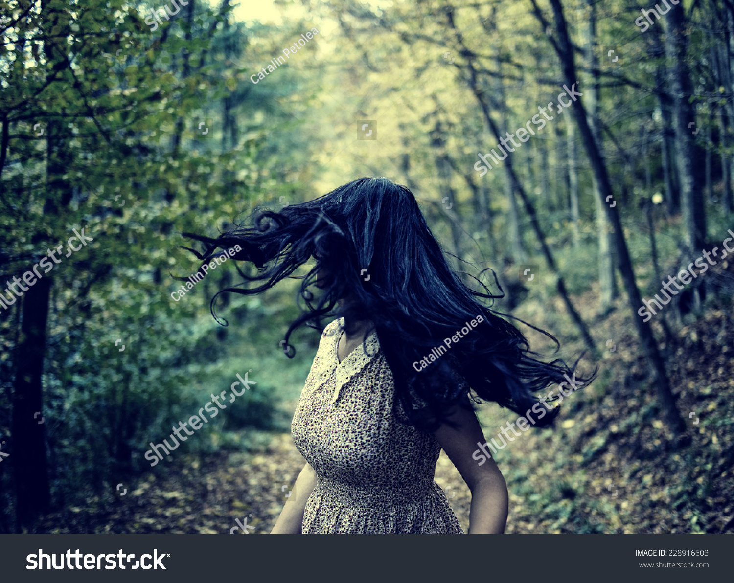 Scared Young Woman Running Through A Forest At Night ...
