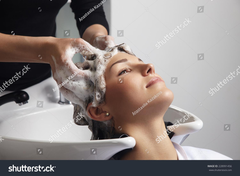 Woman getting hair wash procedure salon stock photo for Wash hair salon