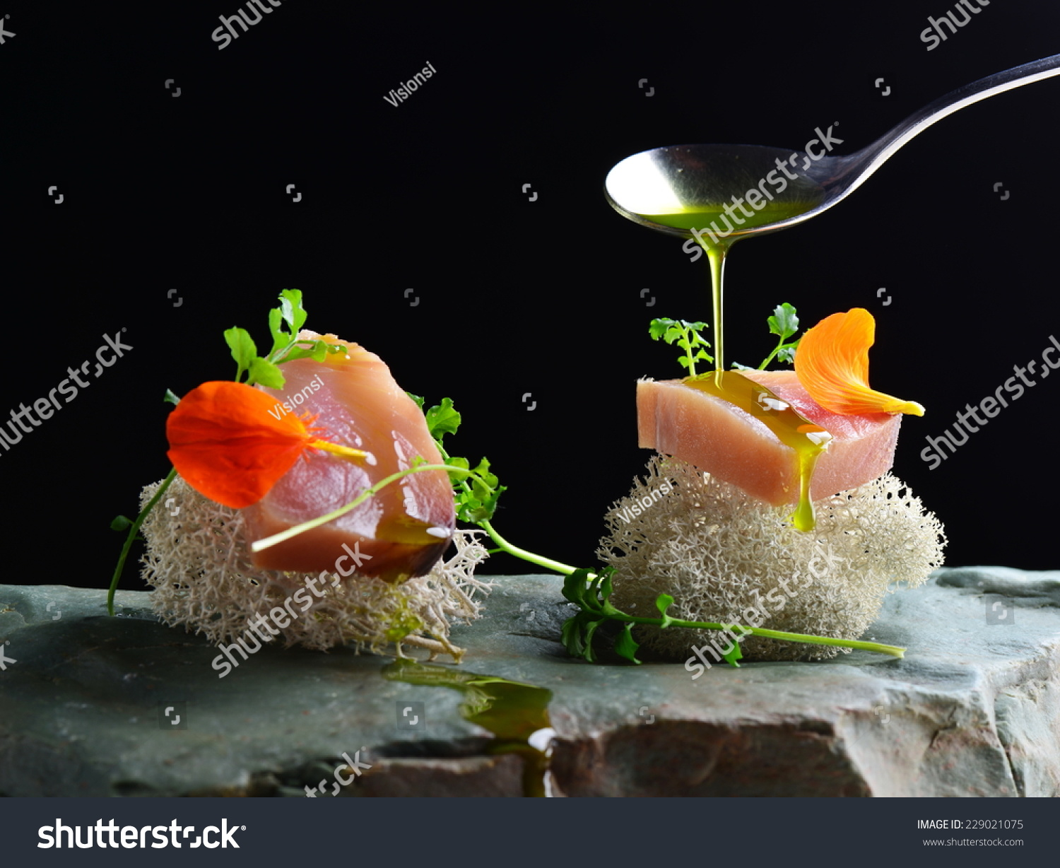 Fine dining, fresh raw ahi tuna sashimi served on sponge with ...