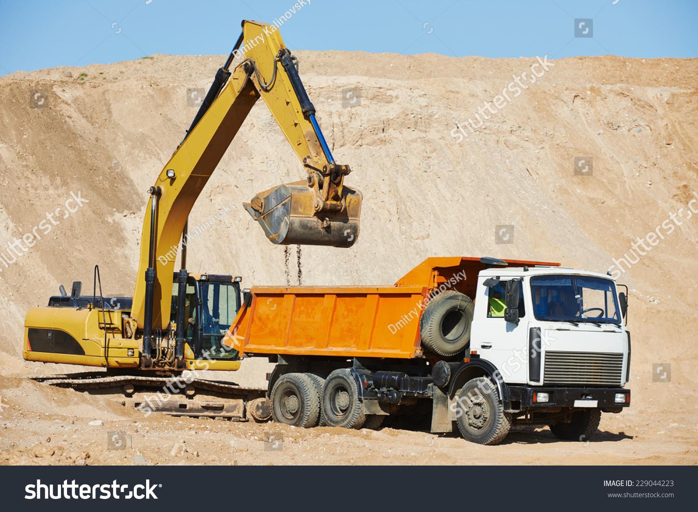 wheel loader excavator machine loading dumper stock photo