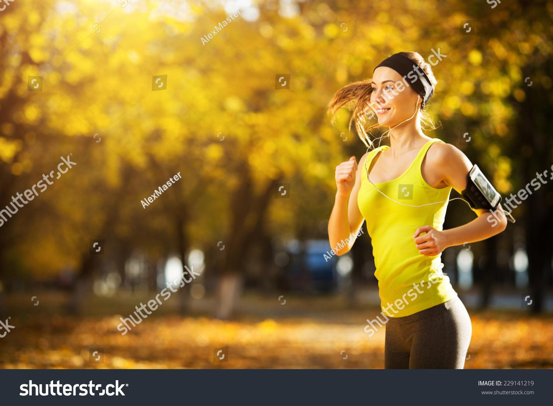 Female Fitness Model Training Outside On Stock Photo ...