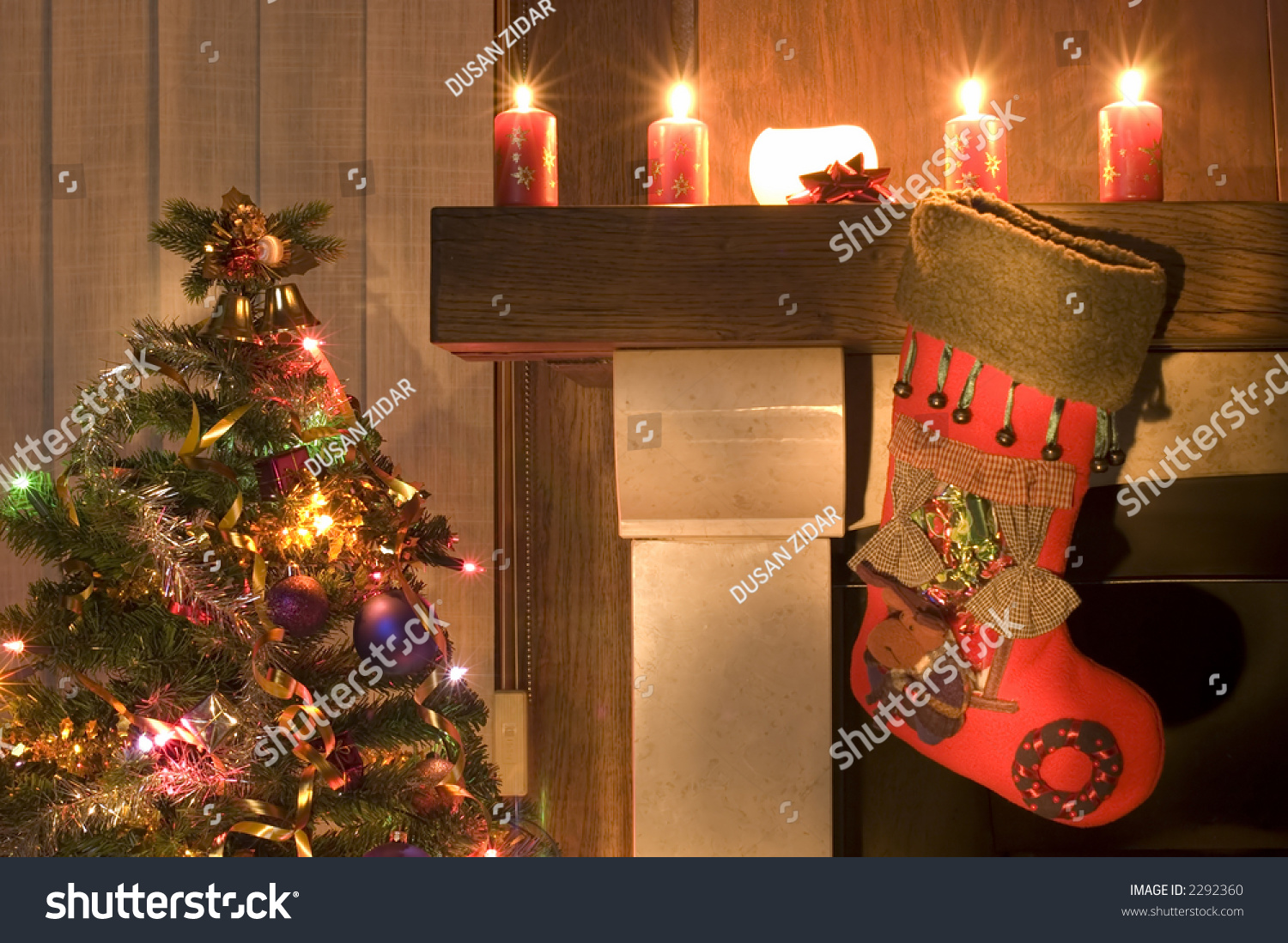 red christmas stocking hangs above fireplace stock photo 2292360