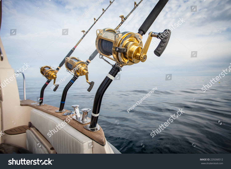 Big game fishing reel in natural setting stock photo for Reel fishing game