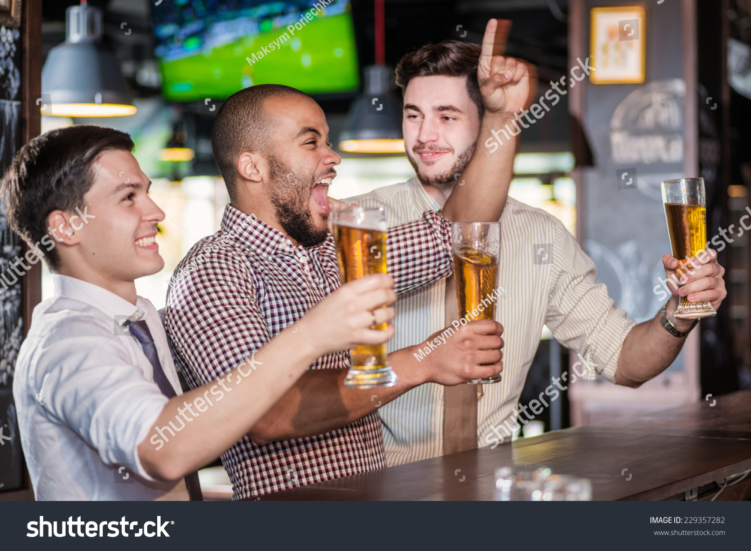 men fans screaming watching football on stock photo 229357282 men fans screaming and watching football on tv and drink beer three other men drinking