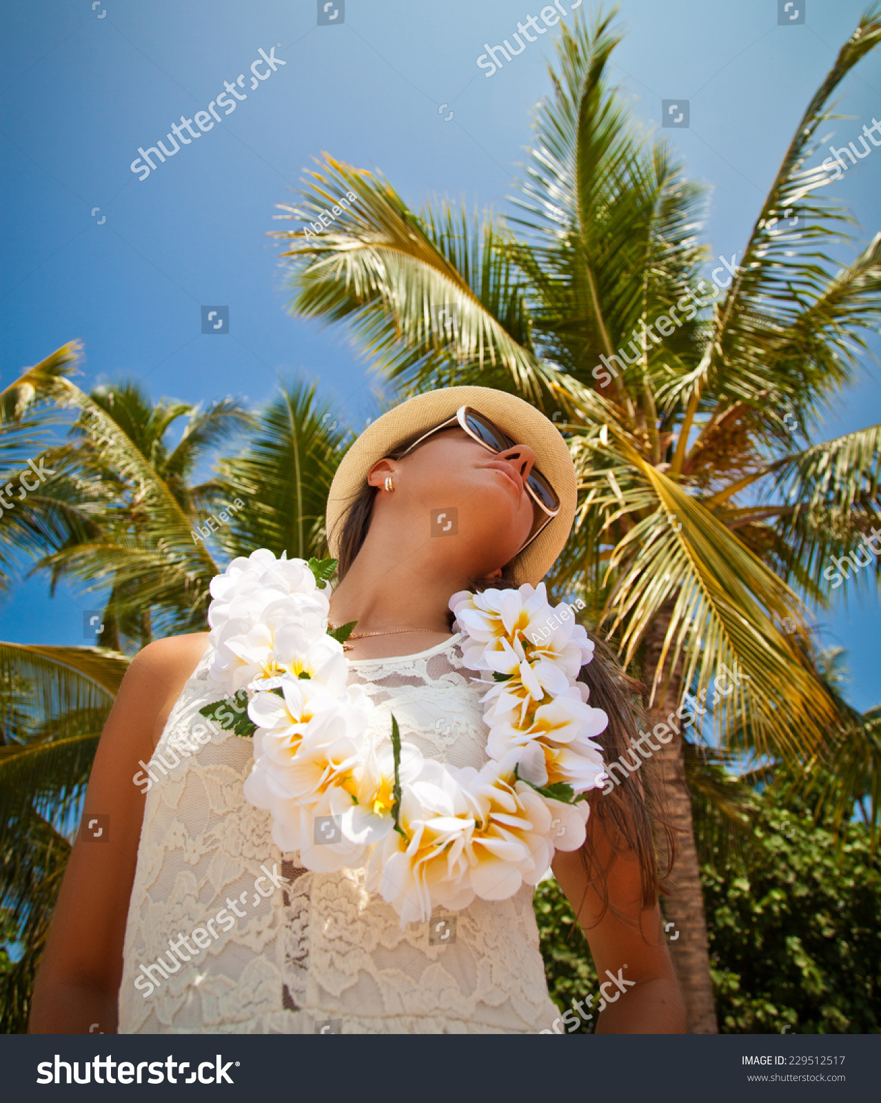 Hawaii woman flower lei garland white stock photo 229512517 hawaii woman with flower lei garland of white flowers portrait of a beautiful young woman izmirmasajfo Images