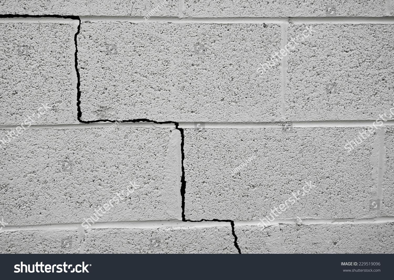 Crack in a cinder block building foundation stock photo for Building a block foundation