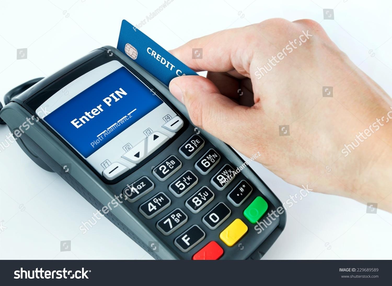 Hand Credit Card Swipe Through Terminal Stock Photo 229689589 ...
