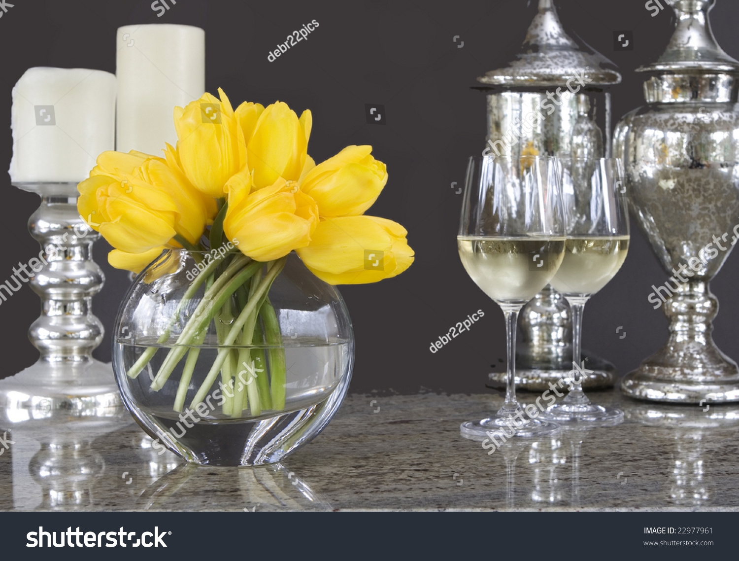 Yellow Tulips In Vase With Glasses Of Wine & Home Decor