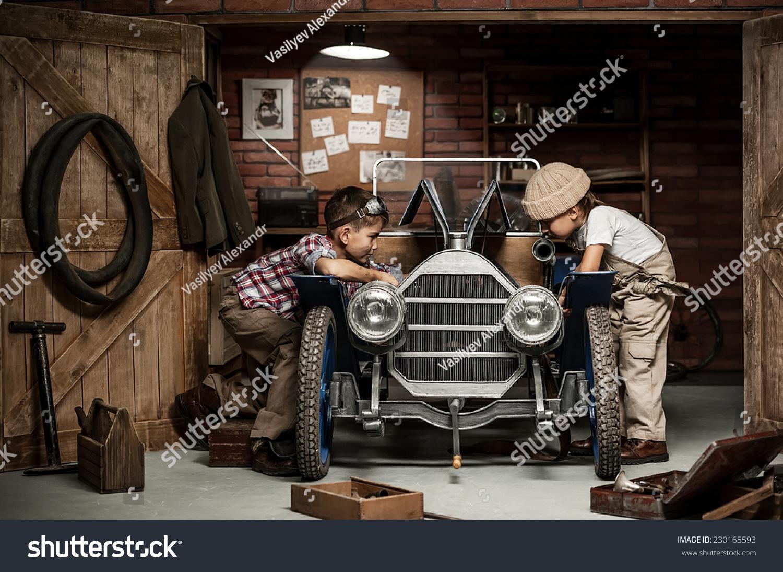 two boys standing mechanic tools retro stock photo 230165593
