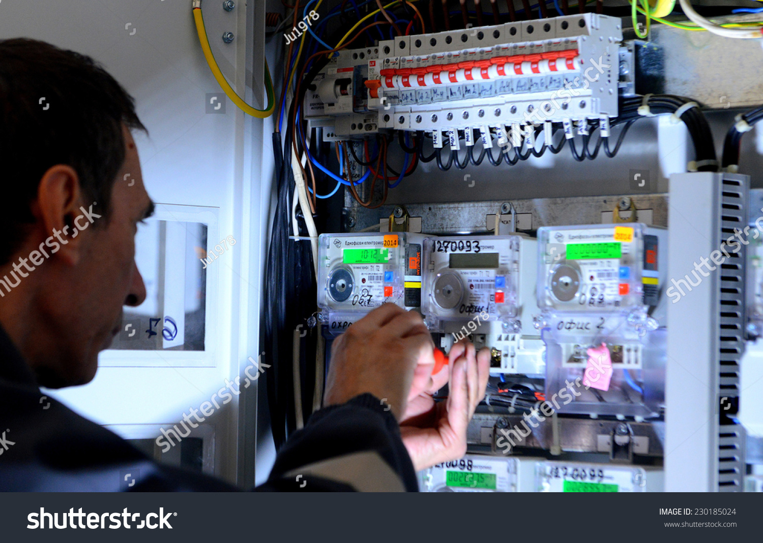 Electrician Builder Engineer Inspecting Electric Counter Stock Photo Fuse Box Equipment In Distribution Building On Sofia