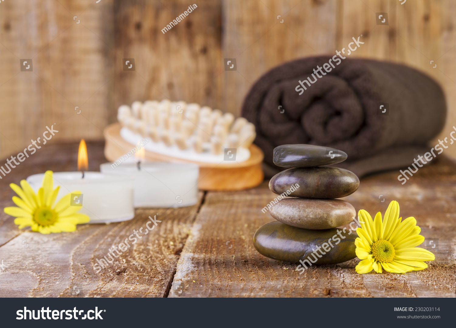 zen basalt stones spa objects candles stock photo   - zen basalt stones and spa objects with candles on the wood