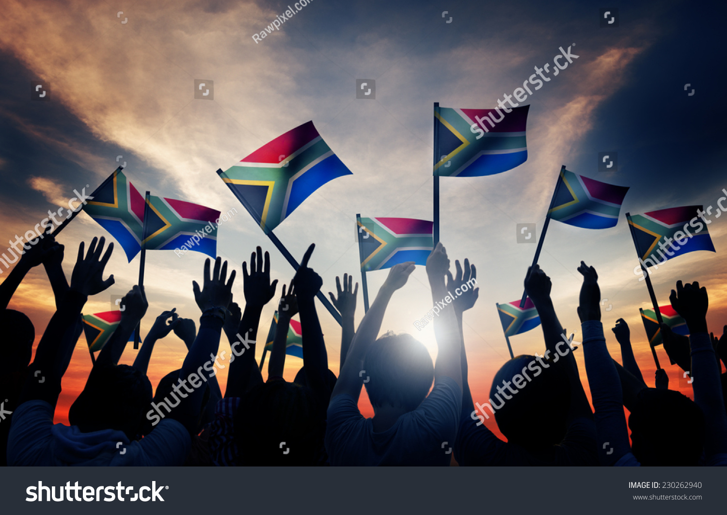 Group of People Waving South African Flags in Back Lit #230262940