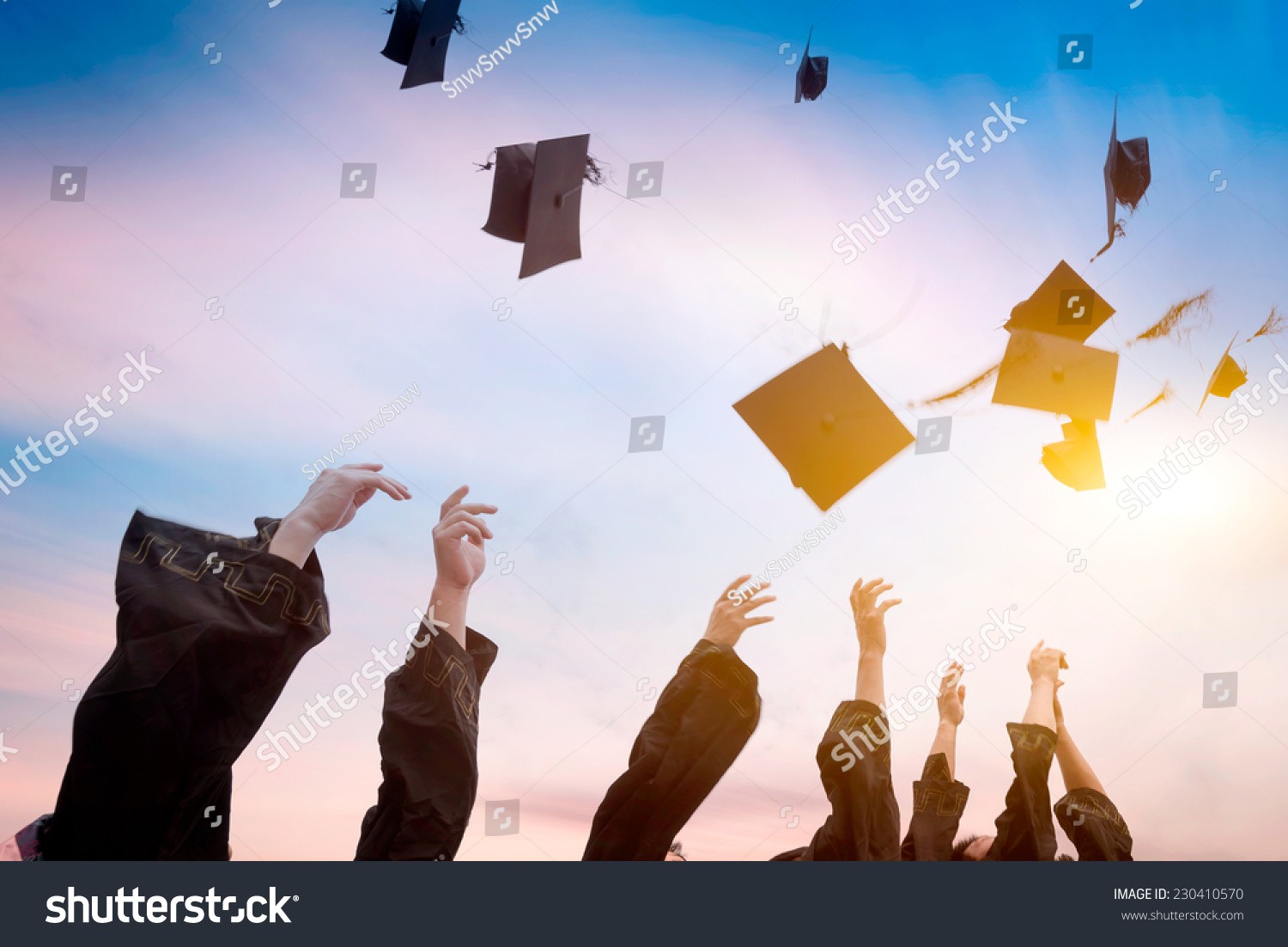 Graduates Throwing Graduation Hats Air Stock Photo ...
