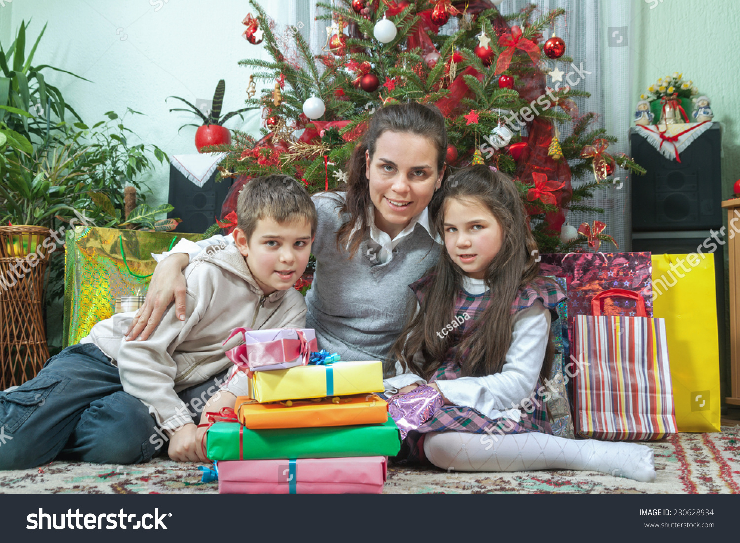 Family Opening Christmas Gifts Home Front Stock Photo (Edit Now ...
