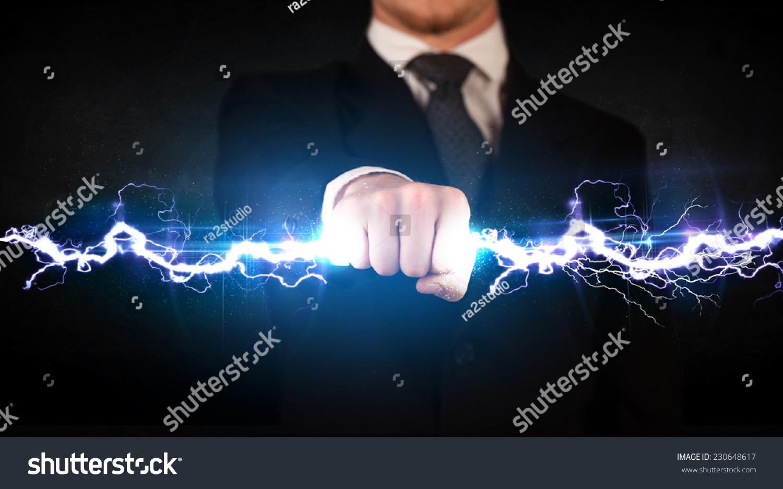 Technology Management Image: Business Man Holding Electricity Light Bolt Stock Photo