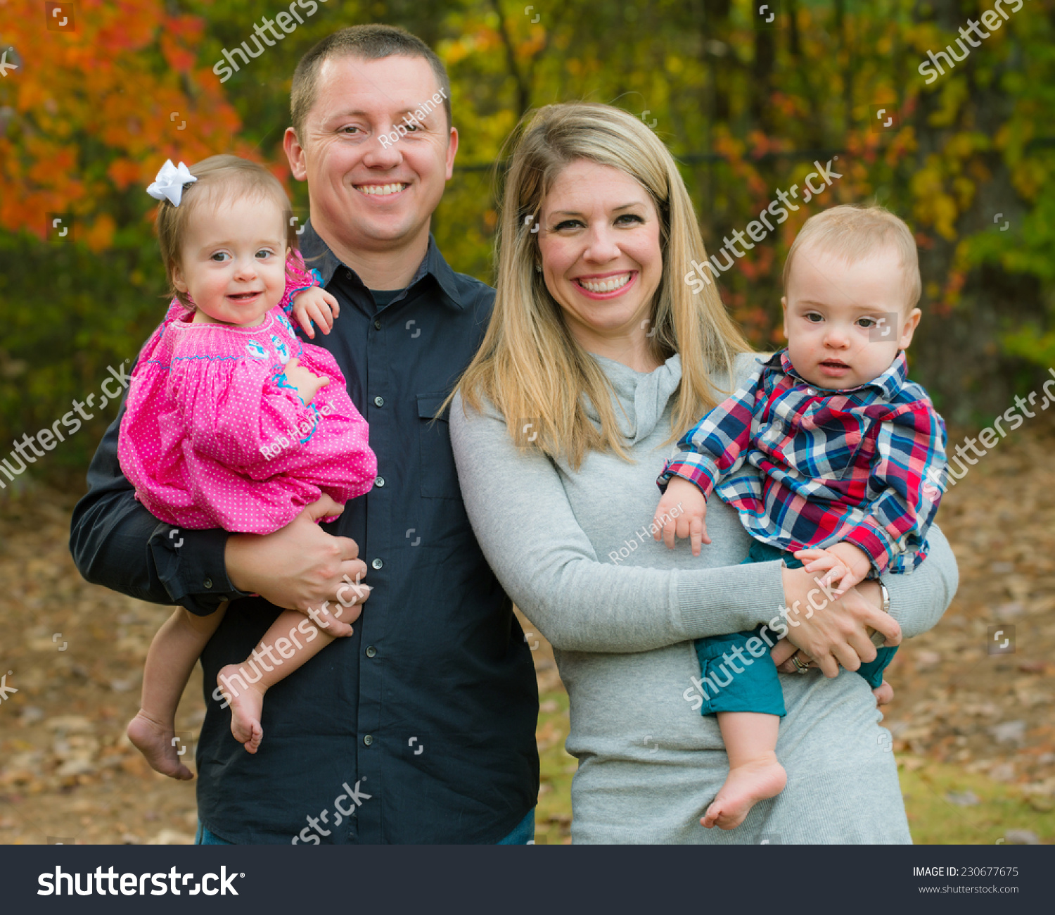 Portrait of family with twin babies during autumn