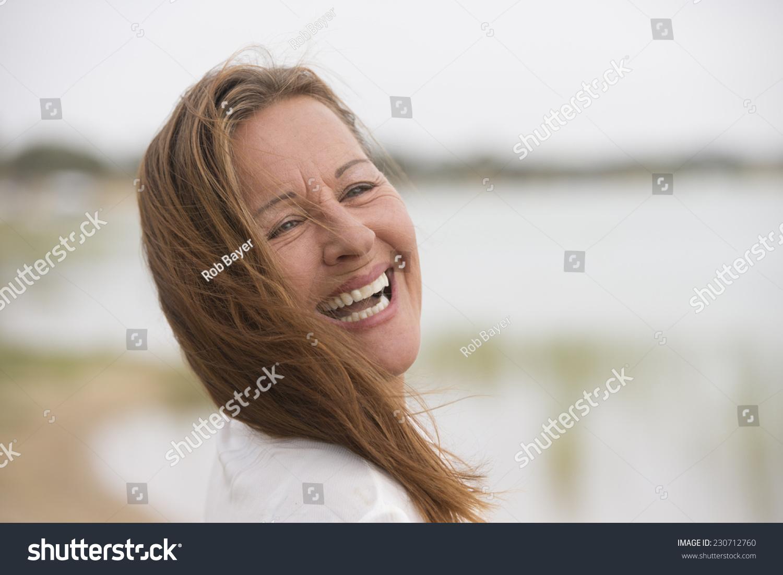portrait attractive confident mature woman outdoor stock photo