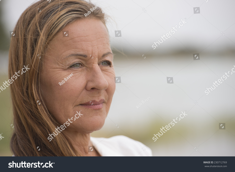 portrait attractive mature woman outdoor looking stock photo