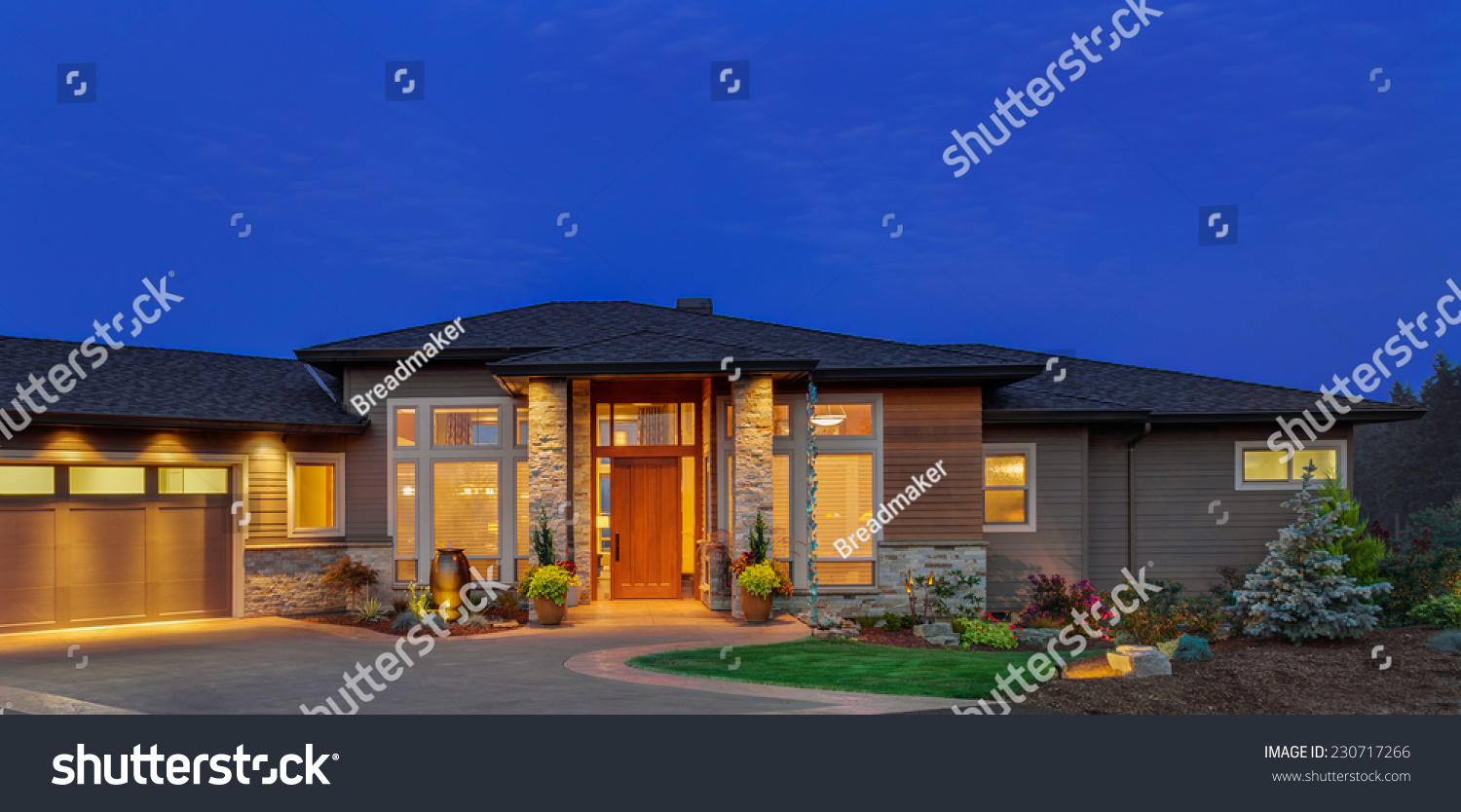 Single story ranch style luxury home exterior at twilight for Luxury single story homes