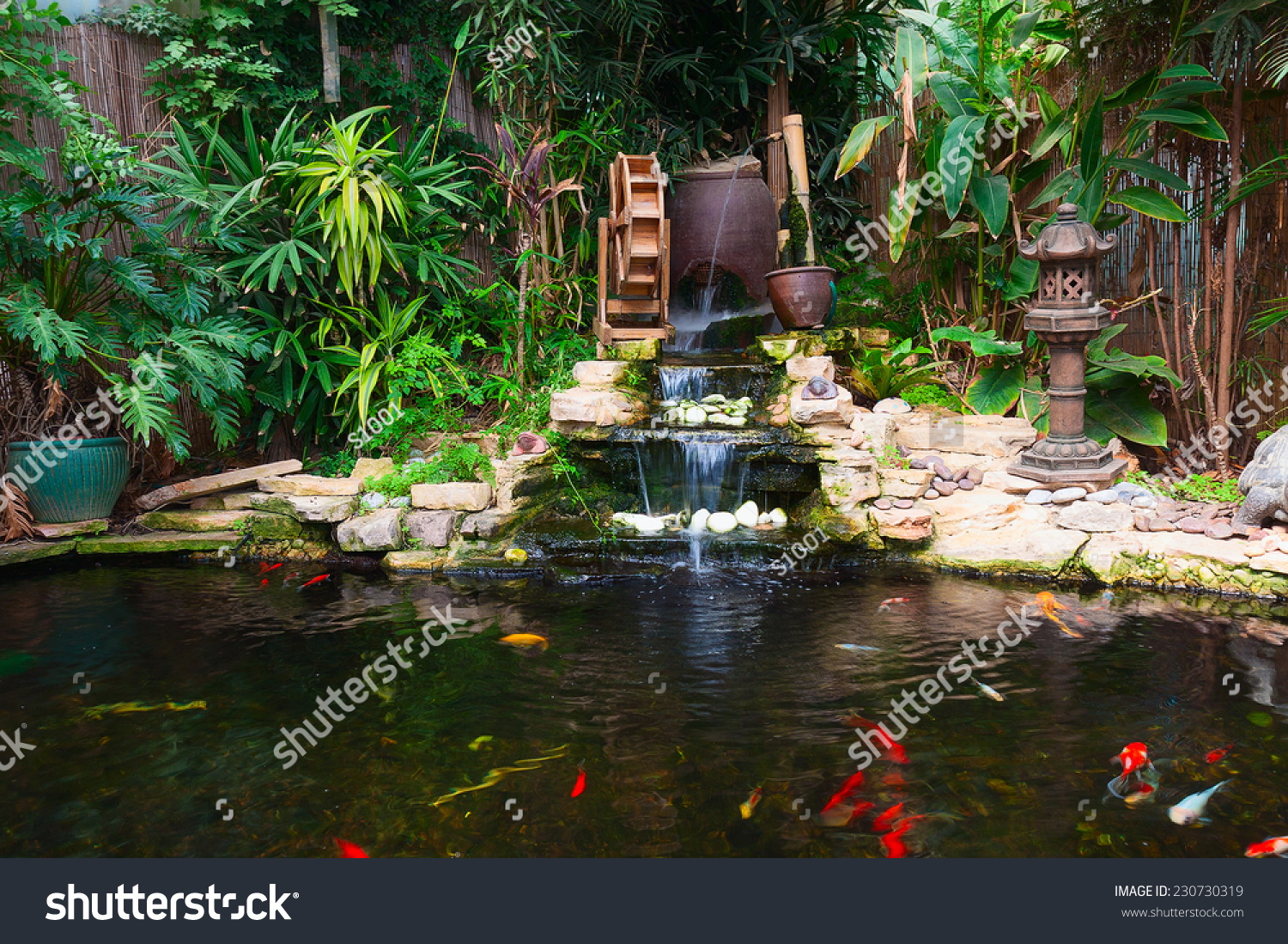 Natural decorative pond with fountain and gold fish stock for Decorative pond fish