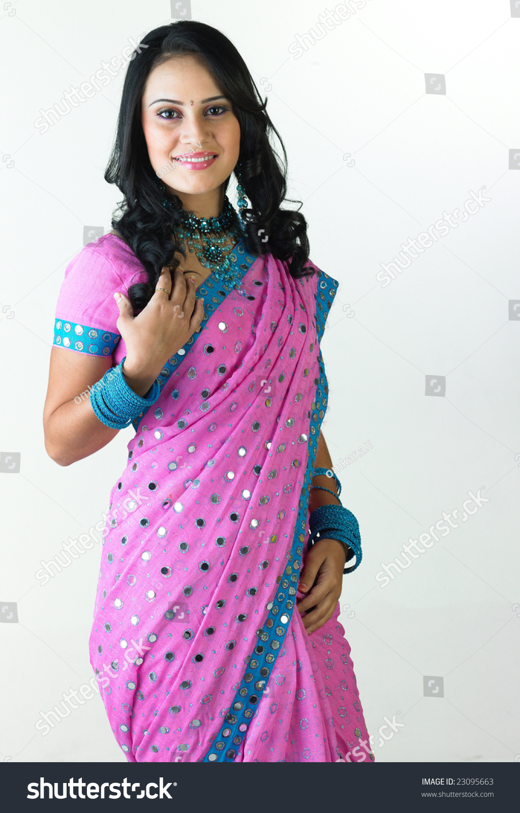 Indian Girl Standing With Free Hairstyle Stock Photo