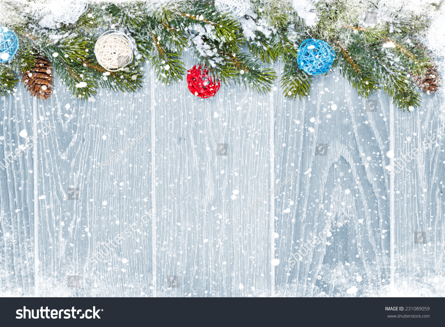 Christmas wooden background with snow fir tree, decor and copy space #231089059