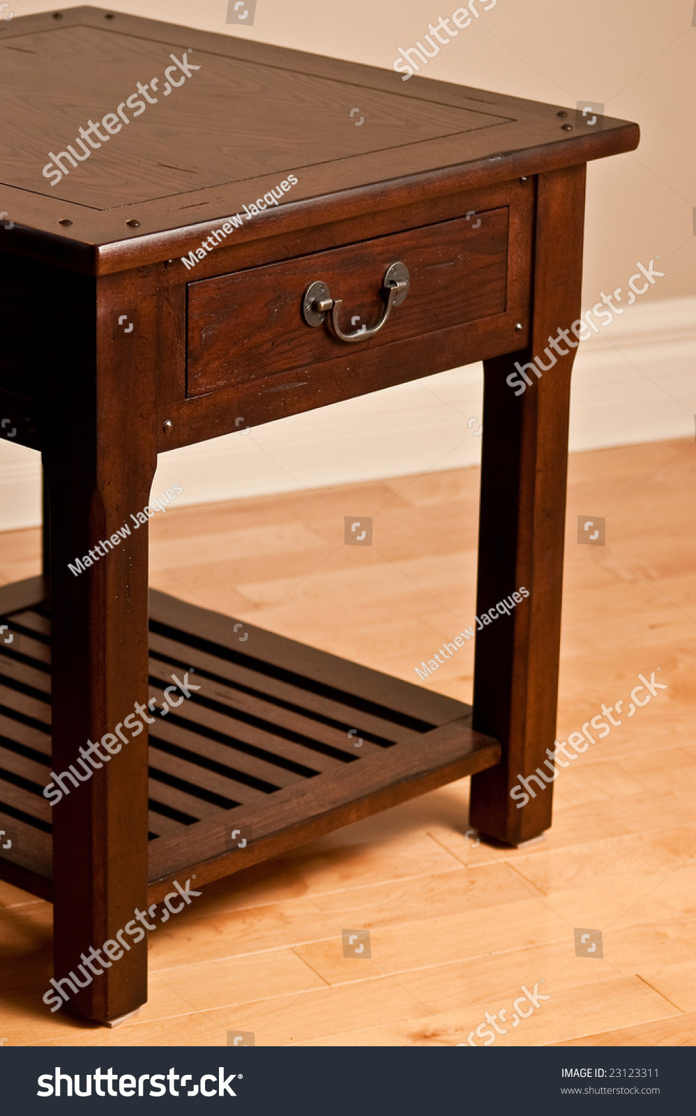 solid wood end table against earth tone wall and hardwood floor  - solid wood end table against earth tone wall and hardwood floor previewsave to a lightbox