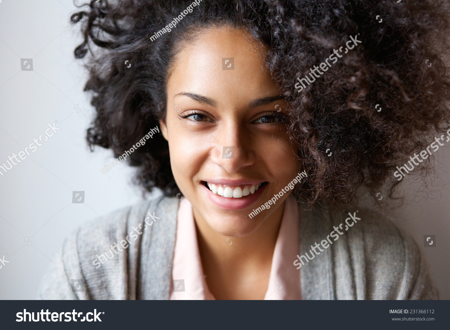 Close up portrait of a beautiful young african american woman smiling #231366112 - 123PhotoFree.com