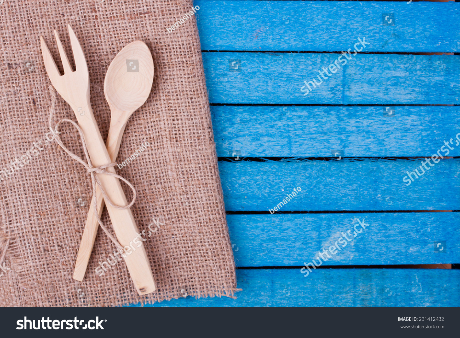 Kitchenware on wooden table with a blue checkered tablecloth | EZ Canvas