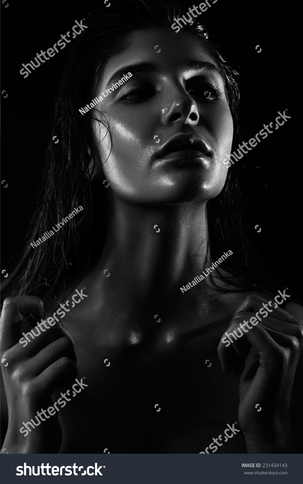Trend beauty at the studio model with wet face skin and hair shooting in black and white image