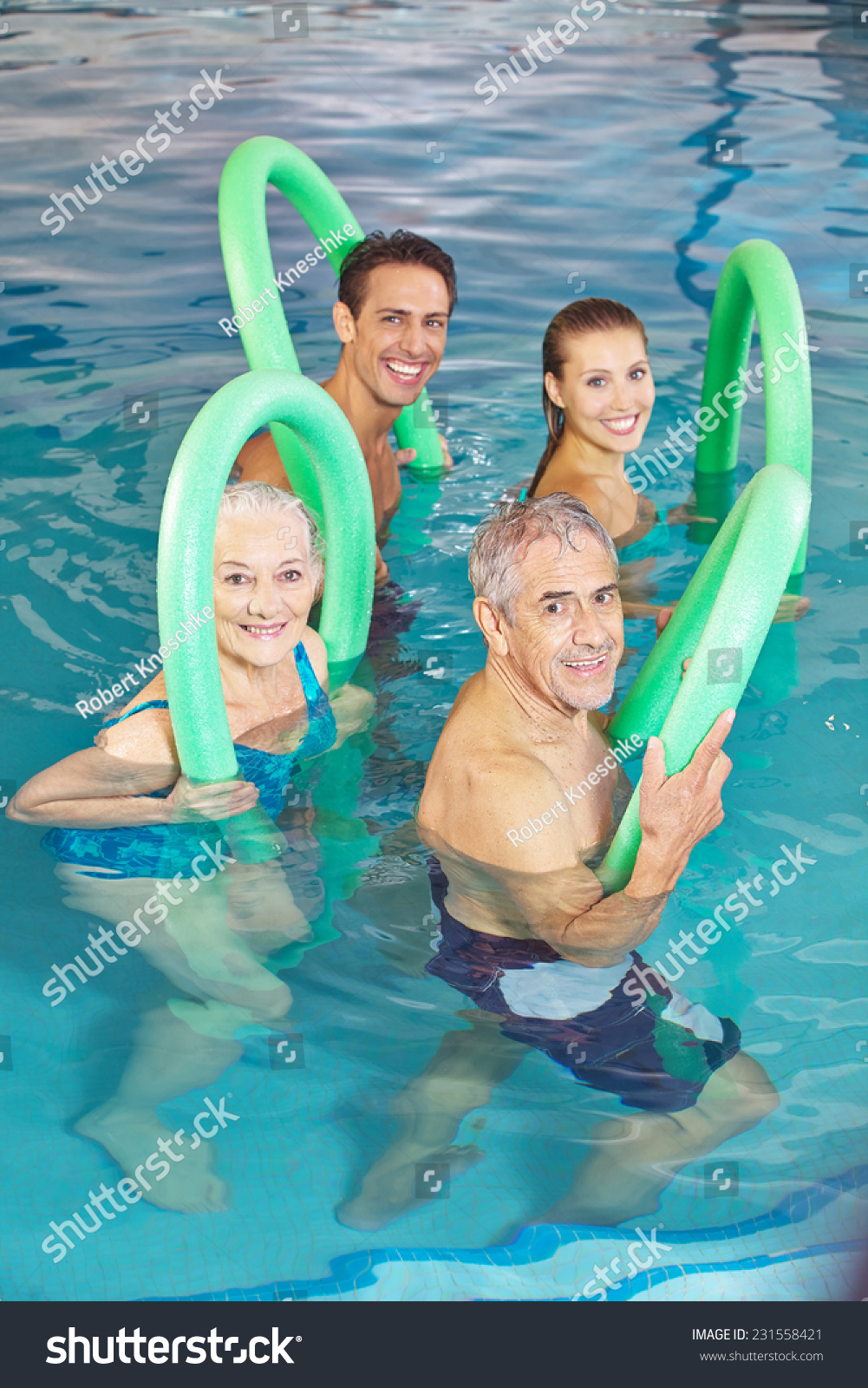 Happy Group Of People In Aqua Fitness Class In Swimming