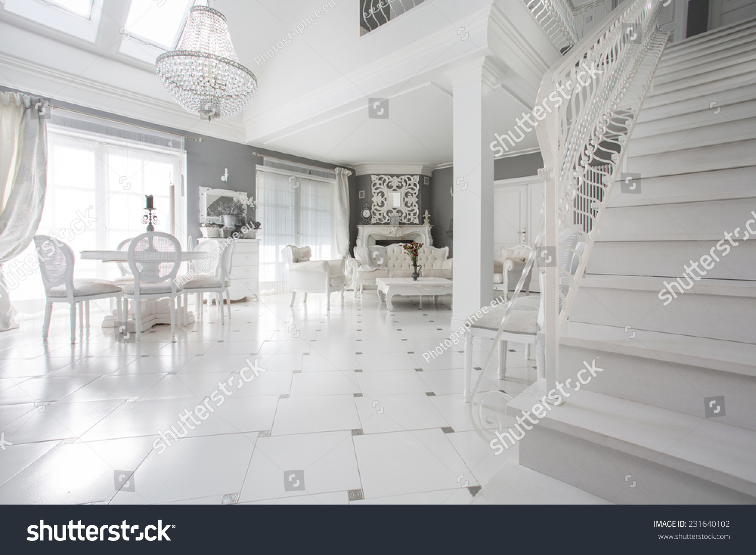 Exclusive White Living Room With Marble Floor Stock Photo