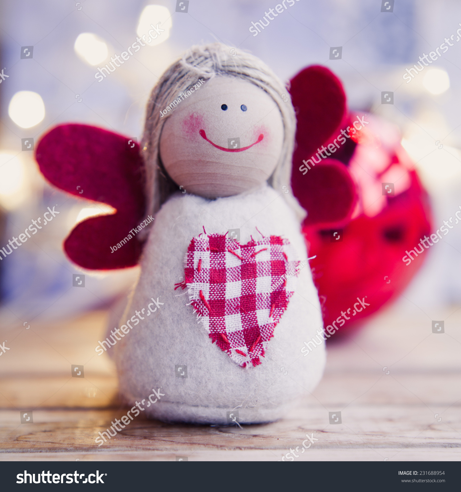 Small christmas angel with red wings family and child