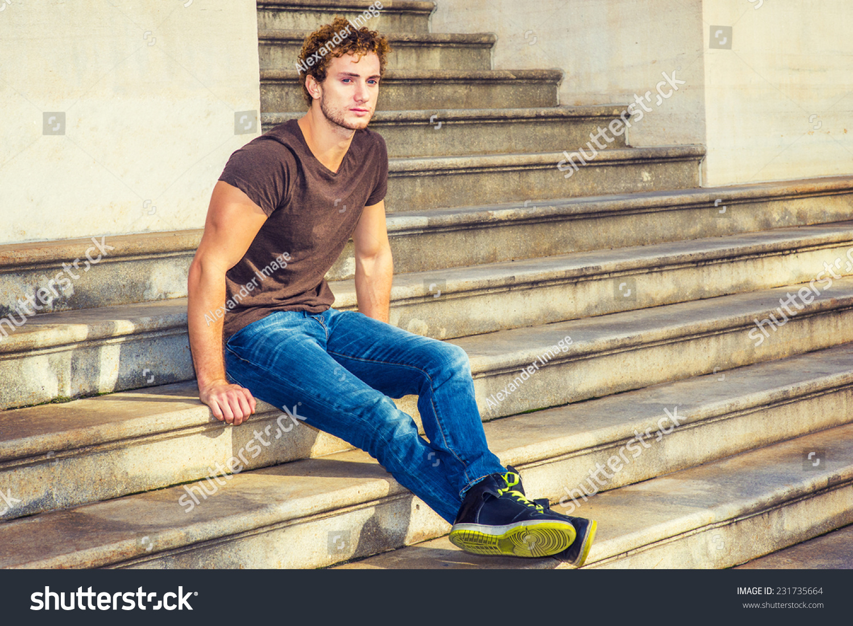 Man Relaxing Outside Wearing Dark Brown Stock Photo 231735664 ...