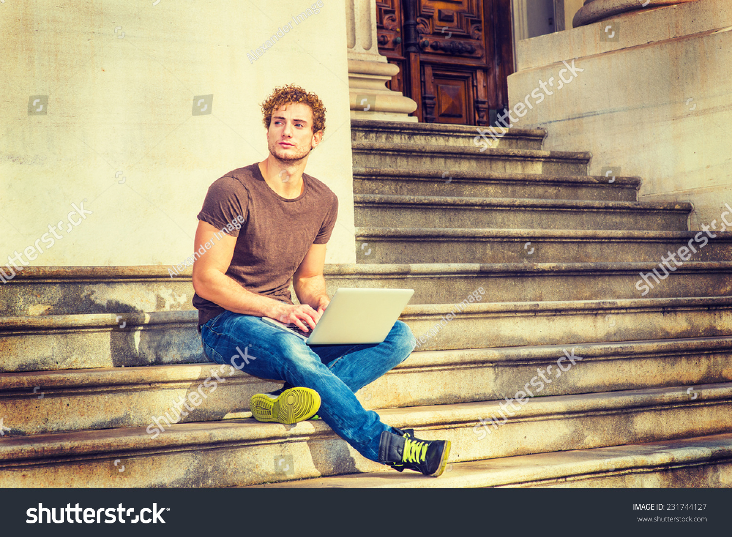 Black t shirt with dark blue jeans - Wearing Dark Brown T Shirt Blue Jeans Black Sneakers A Young Sexy Guy With Curly Hair Is Sitting On Stairs Outside Office Crossing Legs Thinking
