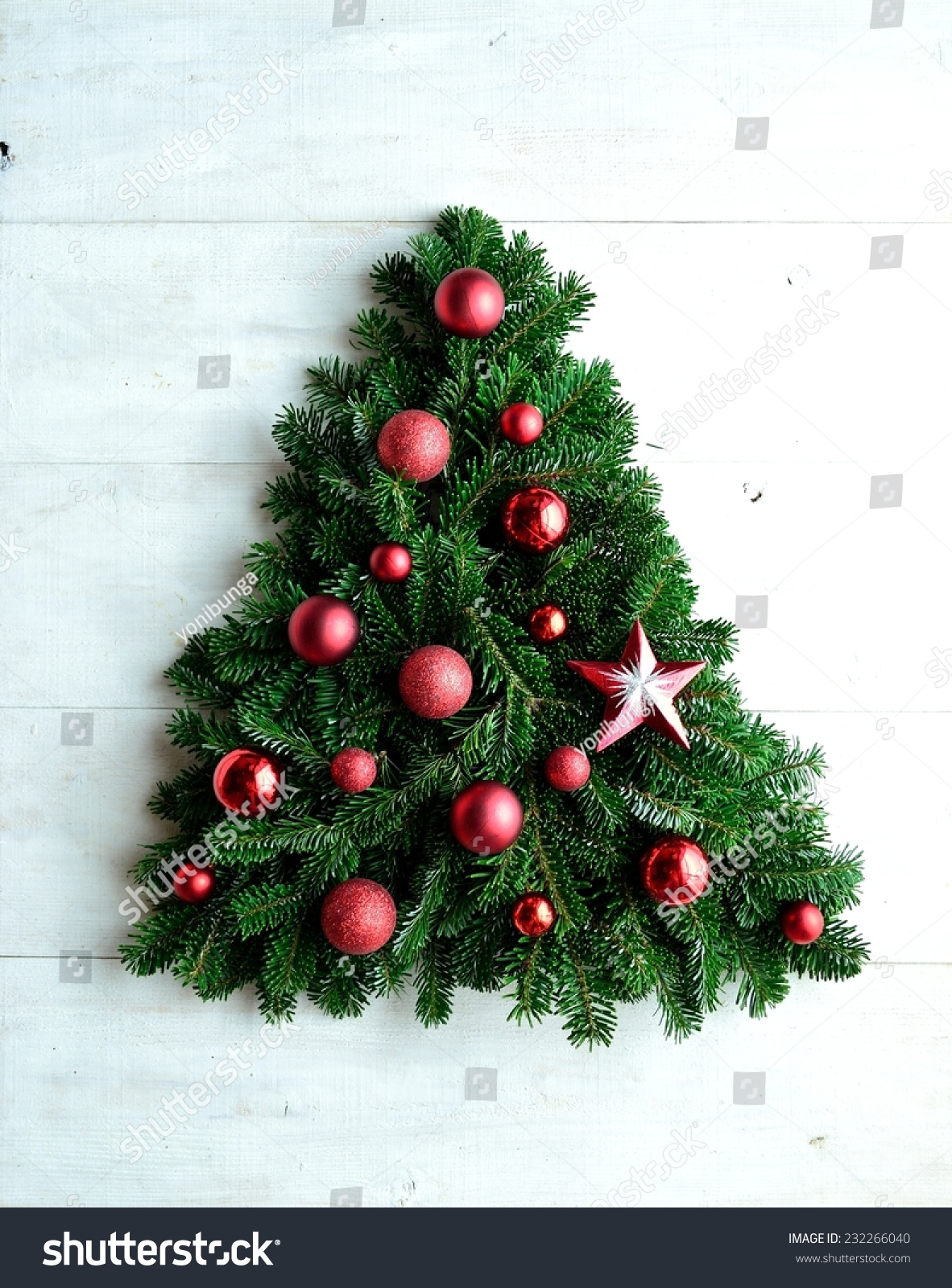 Red star ornament balls christmas tree stock photo