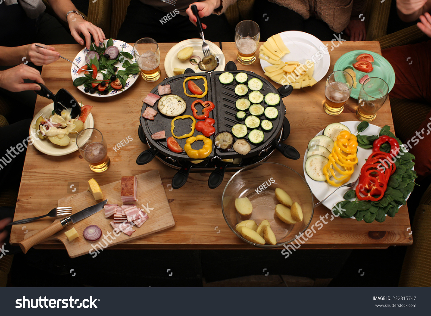 raclette grill party friends eating grilled stock photo 232315747 shutterstock. Black Bedroom Furniture Sets. Home Design Ideas