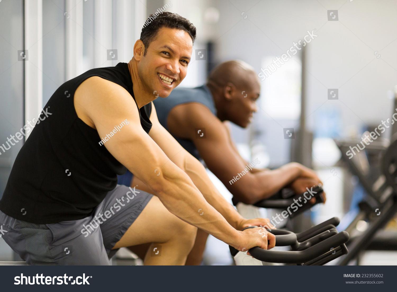 Two Men Doing Indoor Biking Fitness Stock Photo 232355602