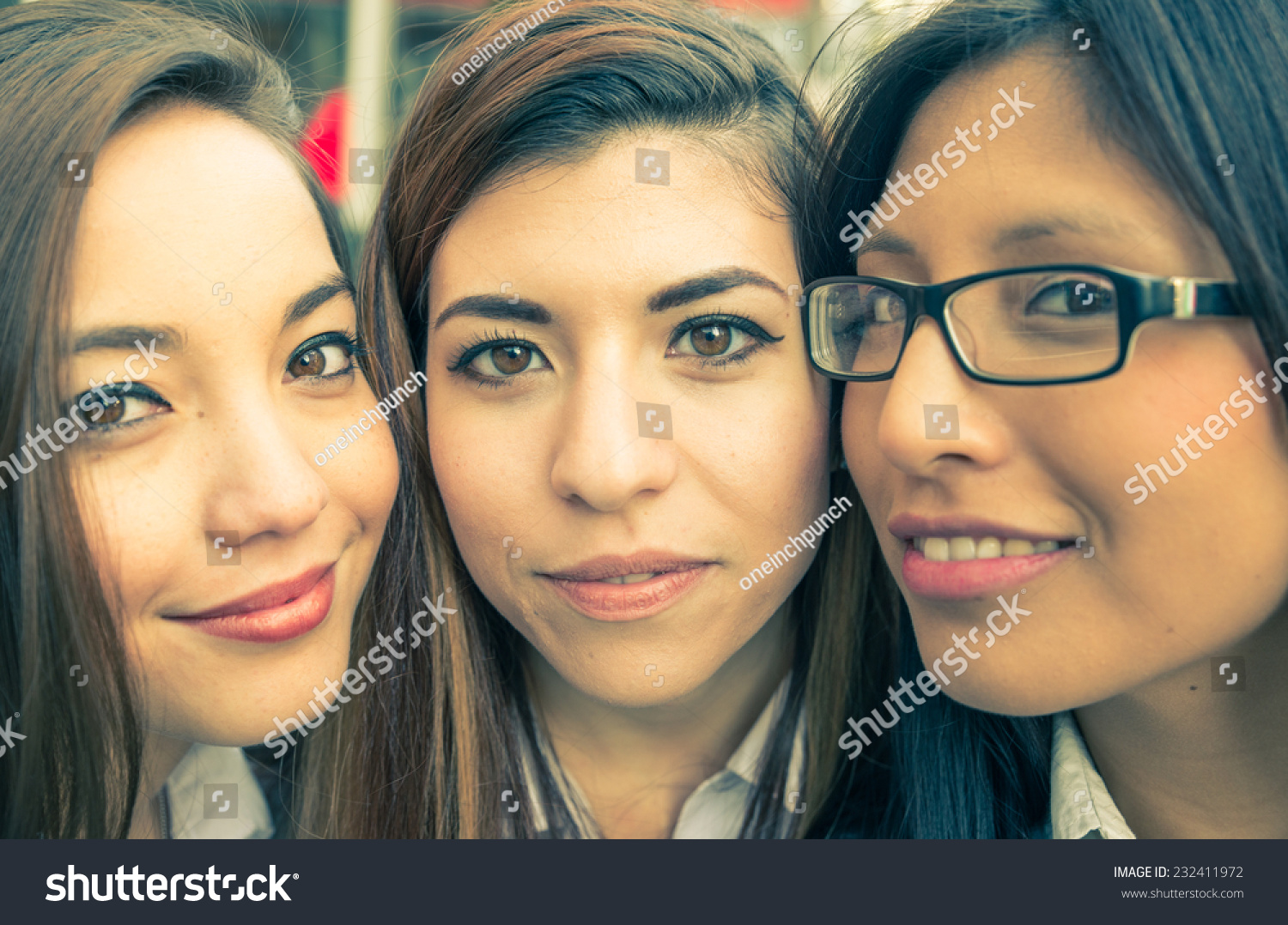 interracial portrait with three girls. asian, caucasian and latin ethnicity
