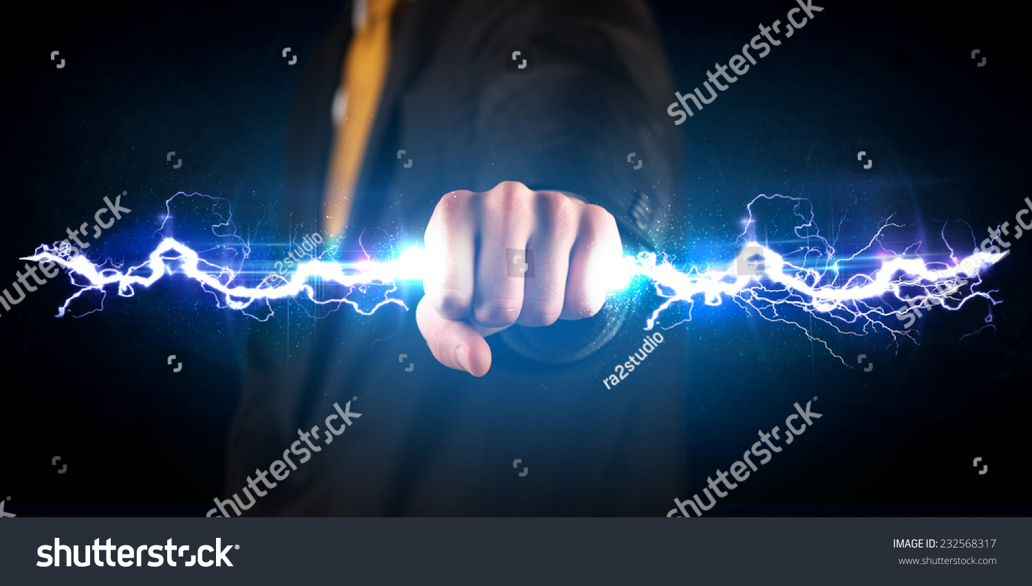 Technology Management Image: Business Man Holding Electricity Light Bolt In His Hands