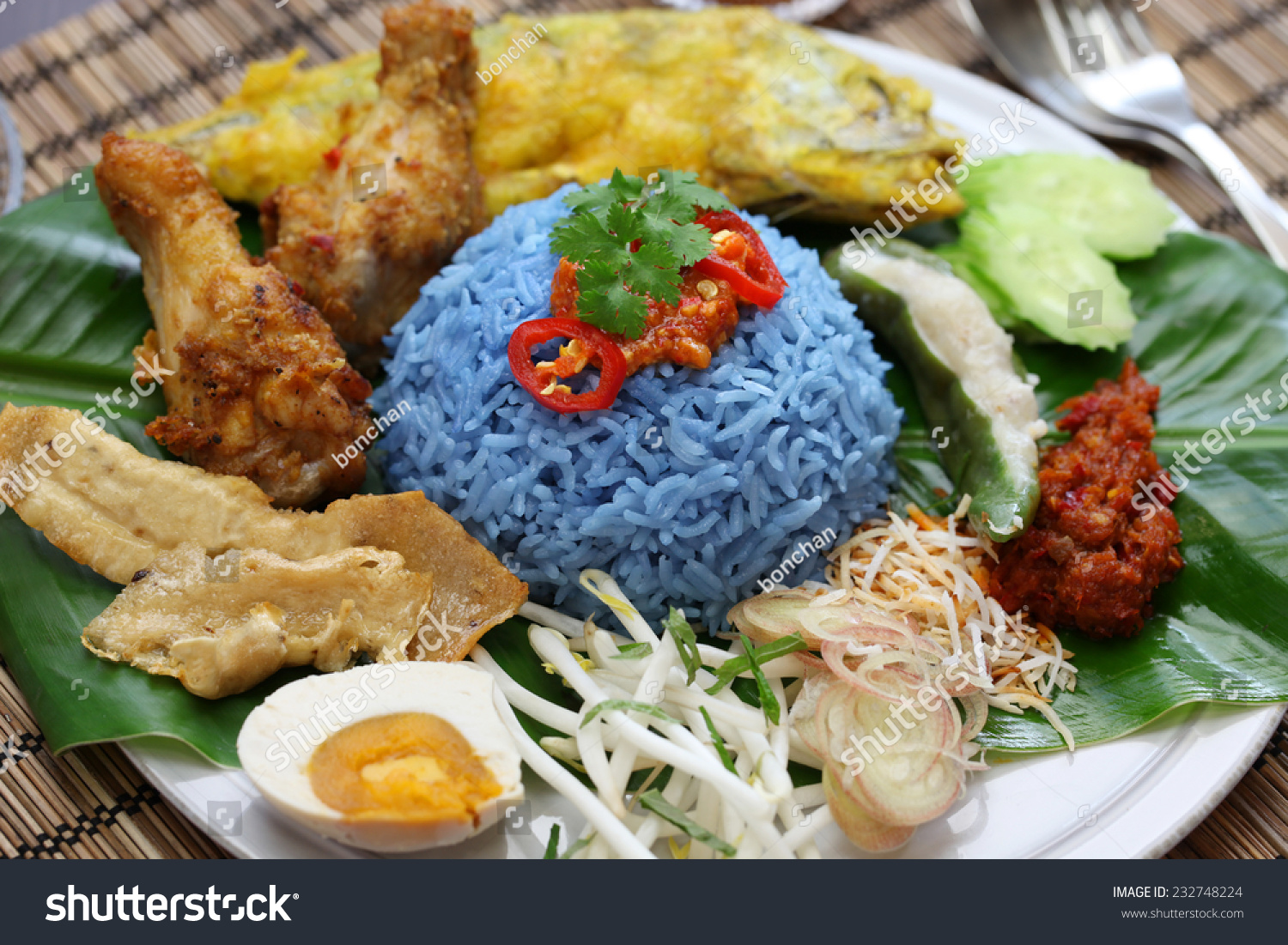 Nasi kerabu blue color rice salad stock photo 232748224 for Authentic malaysian cuisine