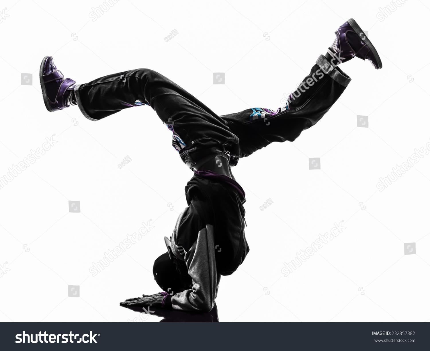 19d0b8ad0 Royalty-free stock photo ID: 232857382. one hip hop acrobatic break dancer  breakdancing young man handstand silhouette white background - Image