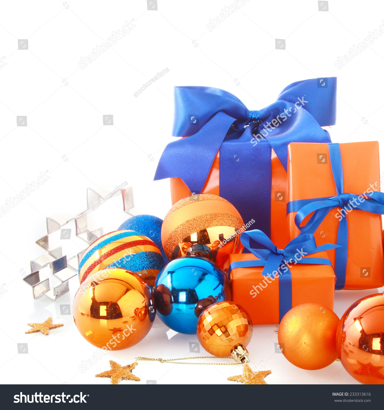 close up attractive blue and orange christmas ornaments with balls stars and presents isolated