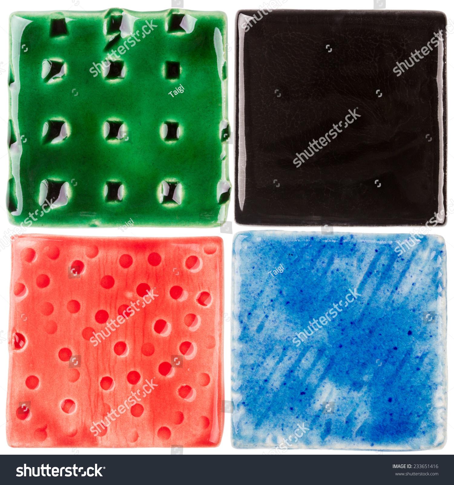 Handmade glazed ceramic tiles isolated on stock photo royalty free handmade glazed ceramic tiles isolated on white dailygadgetfo Choice Image