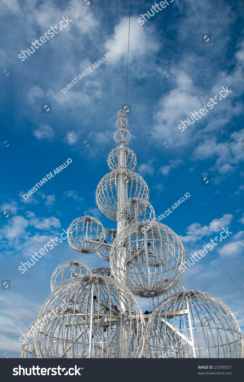 Modern metal christmas tree - Modern Metal Structure Christmas Tree Under Bright Blue Sky