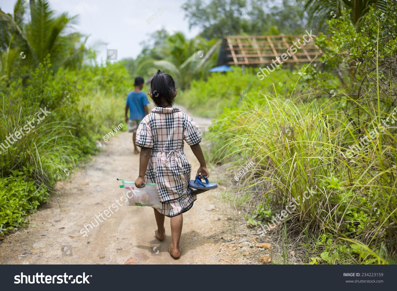 Sungai Petani Malaysia  city photos : SUNGAI PETANI, MALAYSIA: A malay girl is walking on bare feet in a ...
