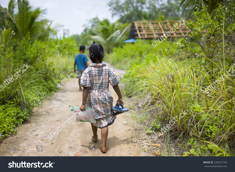 Sungai Petani Malaysia  City new picture : SUNGAI PETANI, MALAYSIA: A malay girl is walking on bare feet in a ...