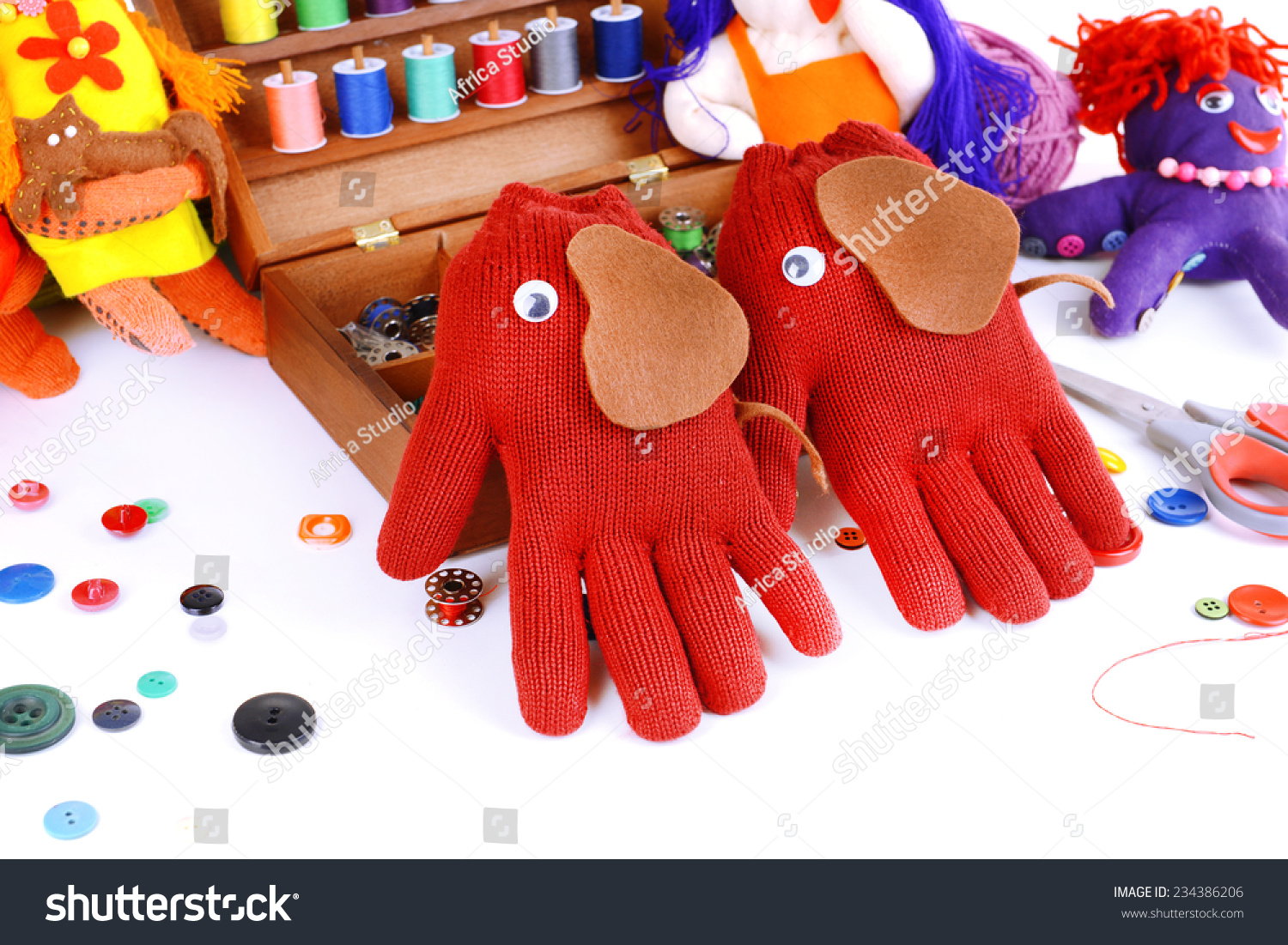 Toys From Africa : Making handmade toys gloves on white stock photo royalty free